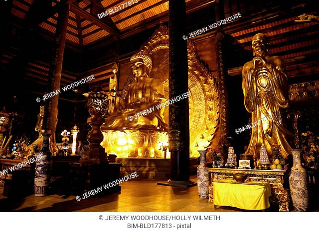 Golden statues in ornate temple