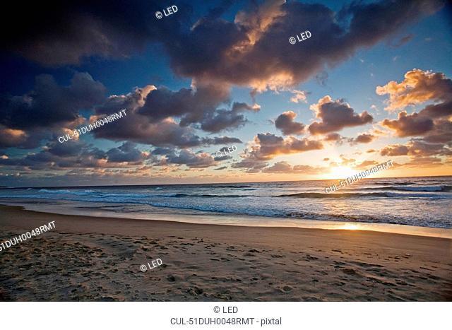 Sun setting over tropical beach