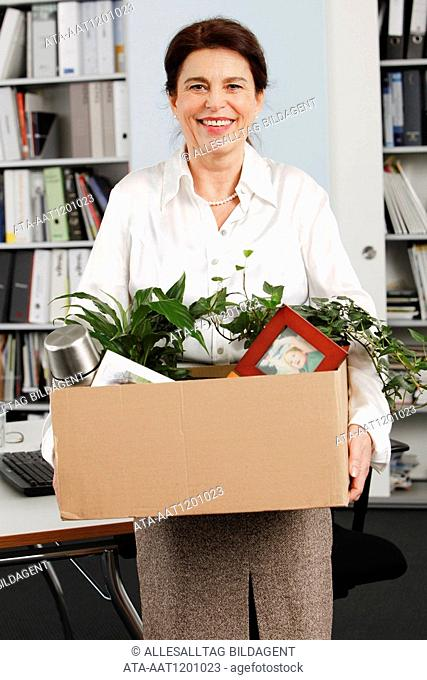 Elderly woman vacating the office