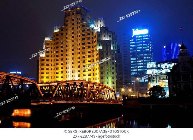 Garden bridge shanghai. Suzhou Creek, Waibaidu (Garden) Bridge, illuminated at night, Shanghai, China. The Waibaidu Bridge, Wàibáidù Qiáo