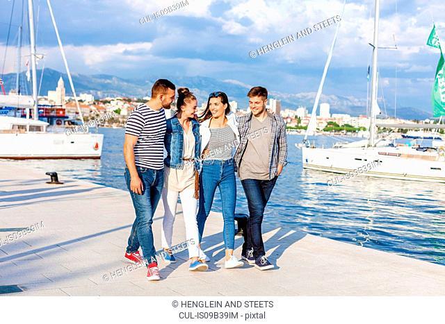 Young couples strolling on harbour, Split, Dalmatia, Croatia