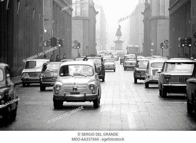 Via Roma in Turin, invaded by road traffic. A sight of Via Roma in Turin, near Piazza San Carlo. Via Roma is invaded by cars: among them