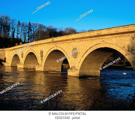 Old stone bridge across river Tweed, Coldstream, Scotland