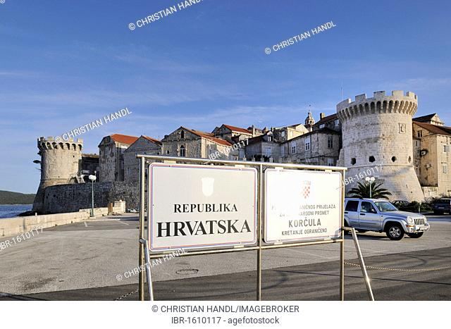Towers of the town wall and a welcome sign, Korcula, Croatia, Europe