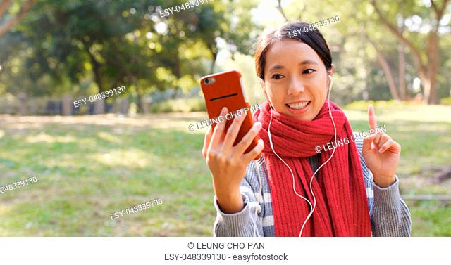Woman making video call in the park
