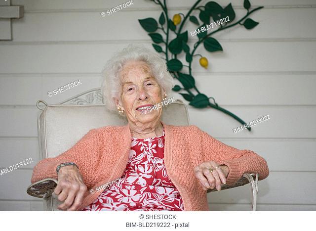 Older Caucasian woman sitting on patio