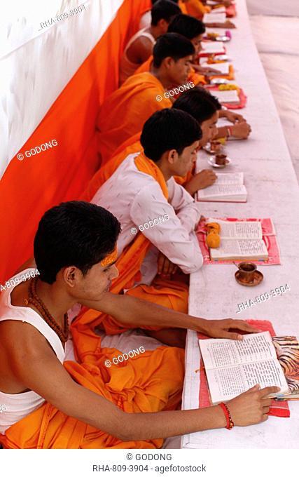 Brahmachari Hindu temple students studying scriptures, Haridwar, India, Asia