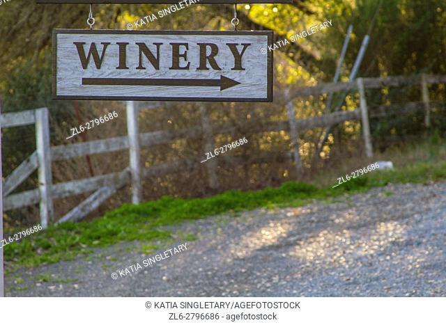 Winery wooded sign that leads to vineyards in Napa and Sonoma, a wine producing area of the California region, on a sunny summer day with blue sky