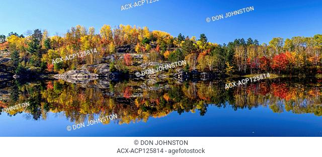 Autumn reflections in Elbow Lake, Greater Sudbury, Ontario, Canada