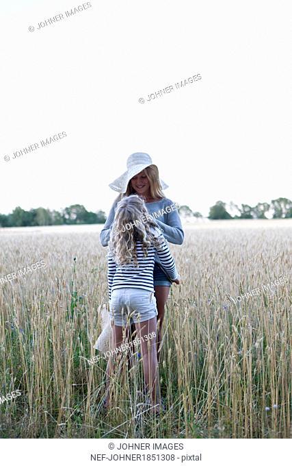 Sisters on wheat field
