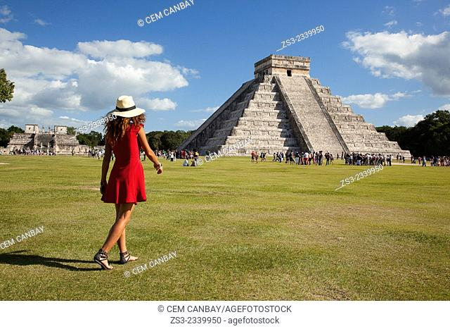 Tourist walking around the Pyramid of Kukulcan-El Castillo, Maya Archeological Site Chichen Itza, Yucatan Province, Mexico, Central America