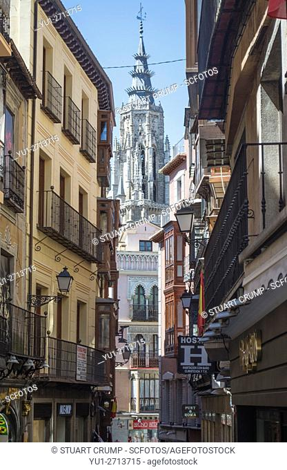 View of Toledo cathedral through a traditional narrow street