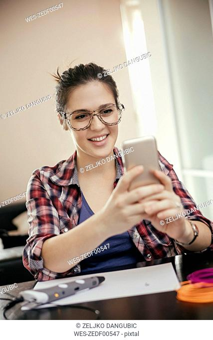 Young woman taking selfie with spectacles, drawn with a 3D pen