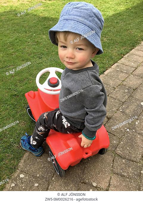 Boy, 2 years old, on a toycar in Ystad, Scania, Sweden