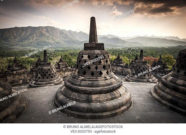 Unroofed pyramid of Borobudur Temple, crowned by bell-shaped stone domes (Magelang Regency, Central Java, Indonesia)