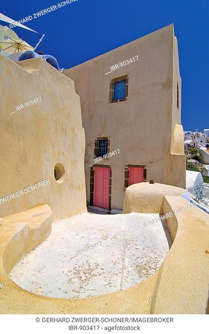 Yellow house in a typical Cycladic architectural style, Oia, Ia, Santorini, Cyclades, Greece, Europe