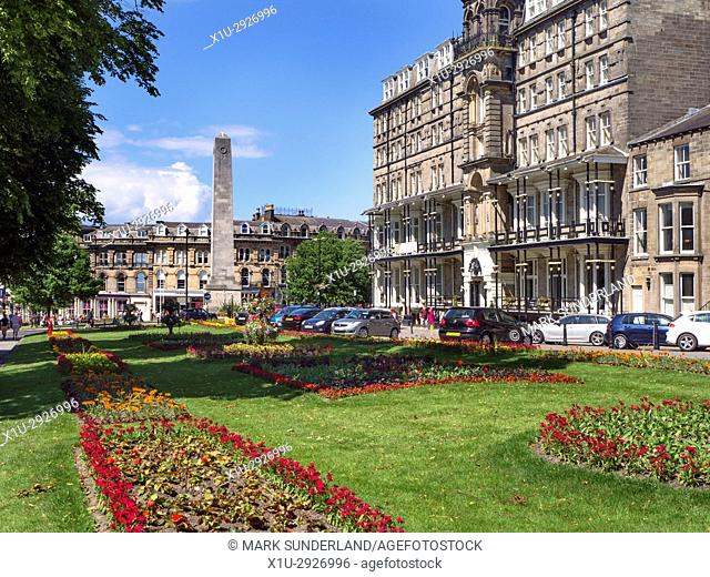 War Memorial and The Yorkshire Hotel on West Park in Harrogate North Yorkshire England