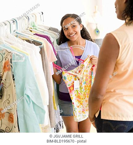 Mother and daughter shopping for clothing together
