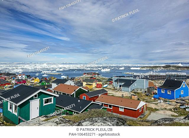 19.06.2018, Gronland, Denmark: Colorful houses of the coastal town of Ilulissat in western Greenland. The city is located on the Ilulissat Icefjord