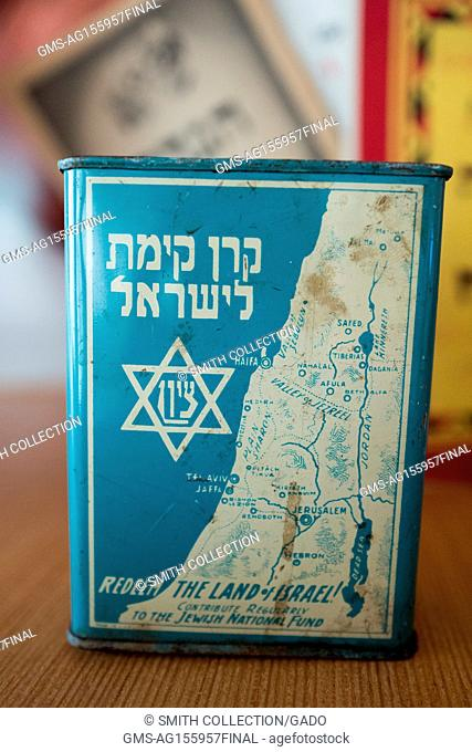 Tin with a map of the country of Israel, with text reading 'Redeem the Land of Israel, Contribute to the Jewish National Fund'