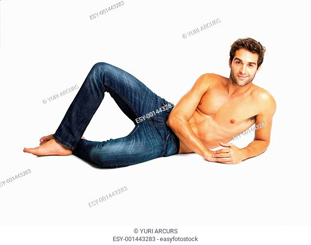 Flirtatious shirtless man lying down