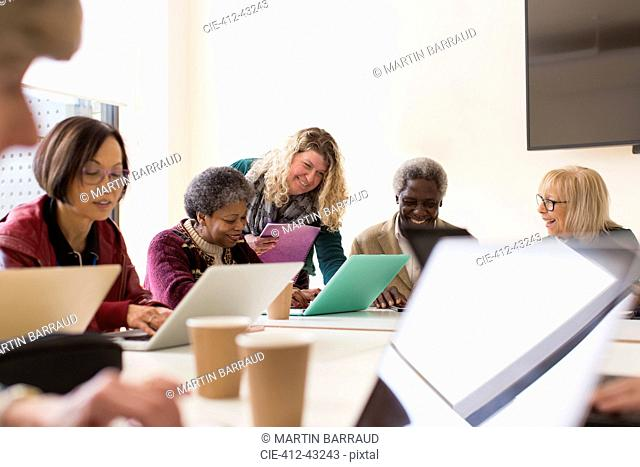 Senior business people in conference room meeting