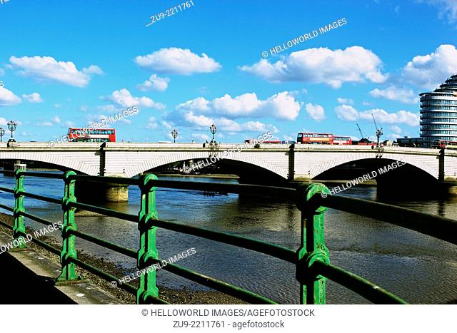 Grade II listed Putney Bridge which opened in 1886, with the 21st century glass Putney Wharf Tower on its south side, London, England, Europe