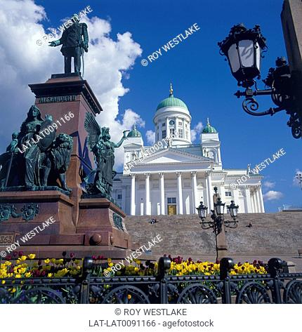Helsinki Cathedral is a distinct landmark in the scenery of central Helsinki,with a tall green dome surrounded by four smaller domes