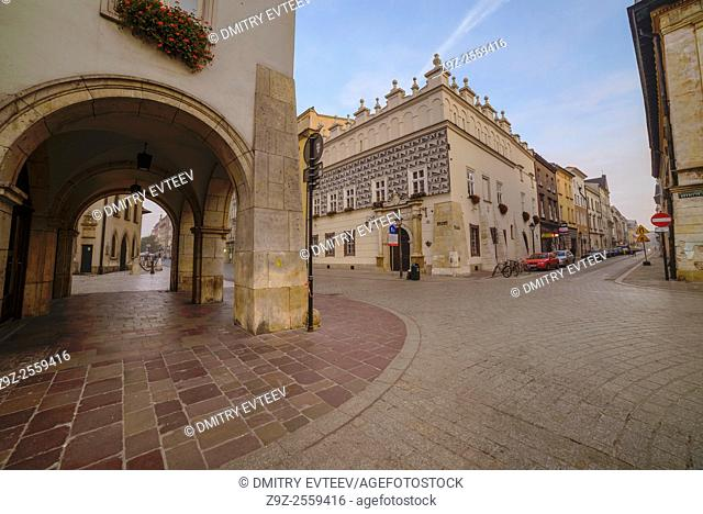 Krakow, Poland. The Szpitalna street near the small market square, perspective view of building's walls. Image is taken in sunrise time