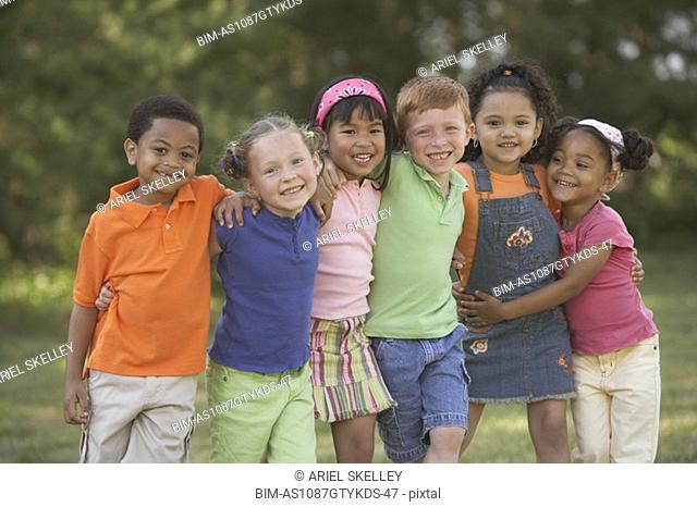 Portrait of multi-ethnic children hugging