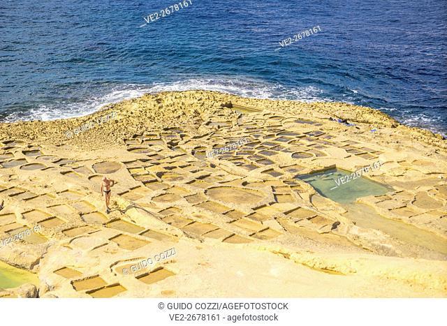 Malta, Gozo . Xlendi, ancient salt ponds near the village