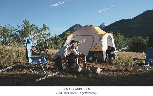 father and children camping