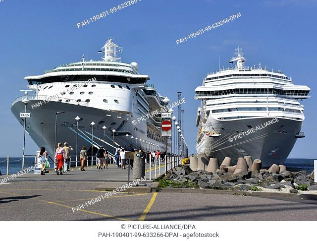 12 July 2018, Estonia, Tallinn: Two cruise ships (MSC Ochestra (l) and Mein Schiff 1 (r)) are located at the cruise terminal of the port city
