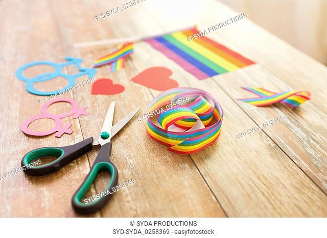 scissors and gay party props on wooden table