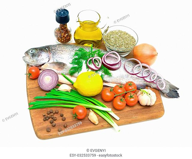 trout and different food on a cutting board on a white background. horizontal photo