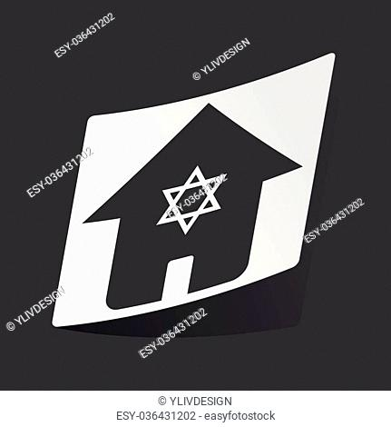 White sticker with black image of house with Star of David, on black background