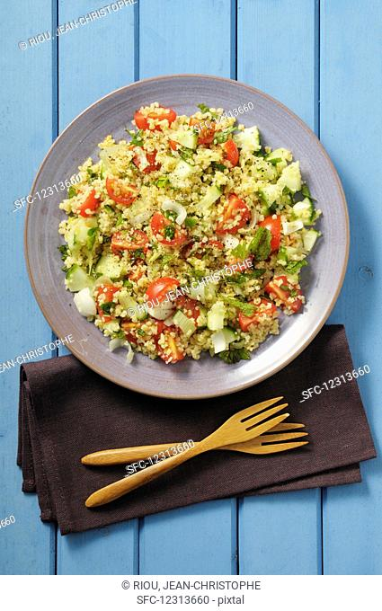 Tabouleh with tomatoes, cucumbers, mint and parsley