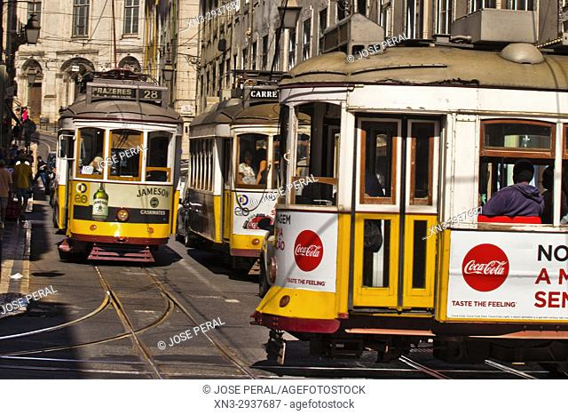 Trams, Rua da Conceição Street, on background Main façade of the Magdalene Church, Igreja da Madalena, Lisbon, Portugal, Europe