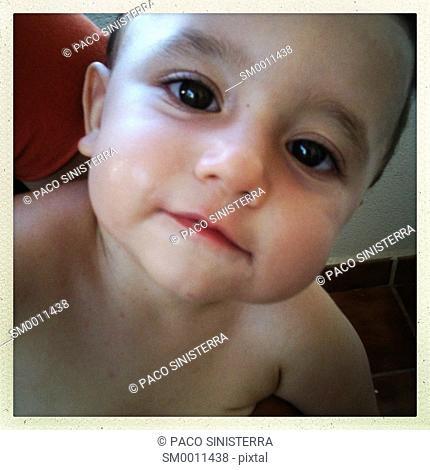 Baby looking at camera, Valencia, Spain