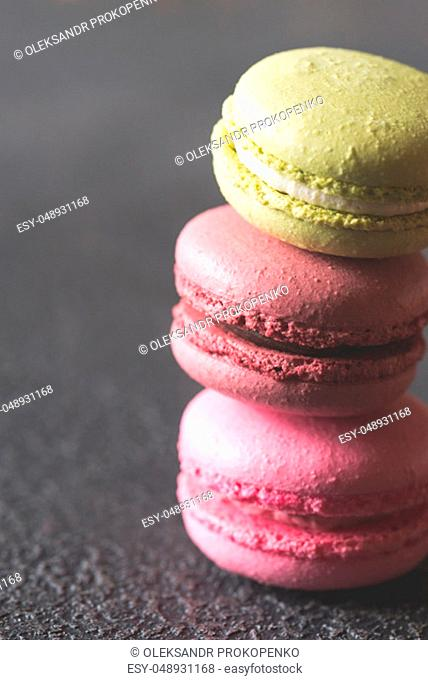 Colorful macarons on the dark background