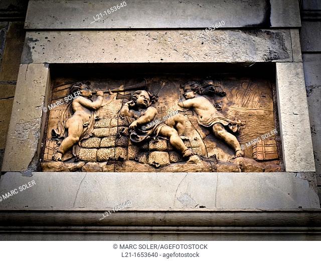 High relief in stone in Casa Xifré, Pla de Palau, Barcelona, Catalonia, Spain