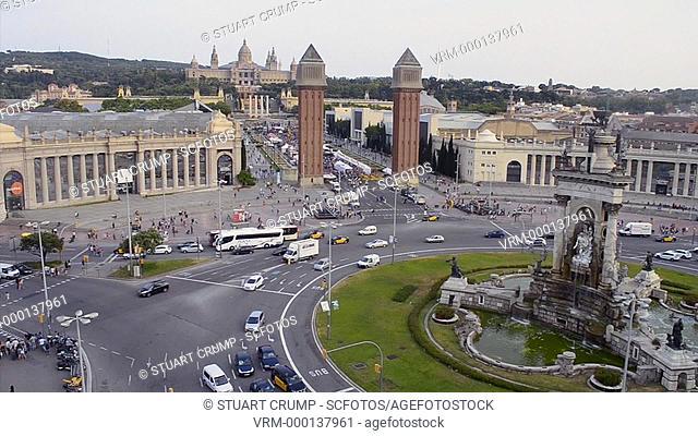 Traffic drives around the Plaza de Espana in Barcelona Catalunia Spain