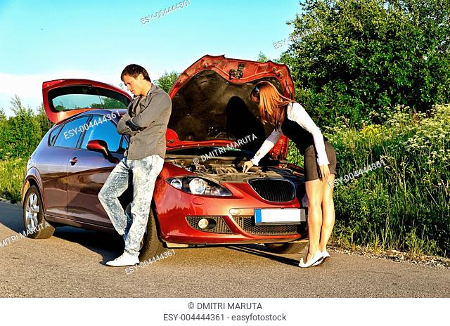 Man and woman near the broken car