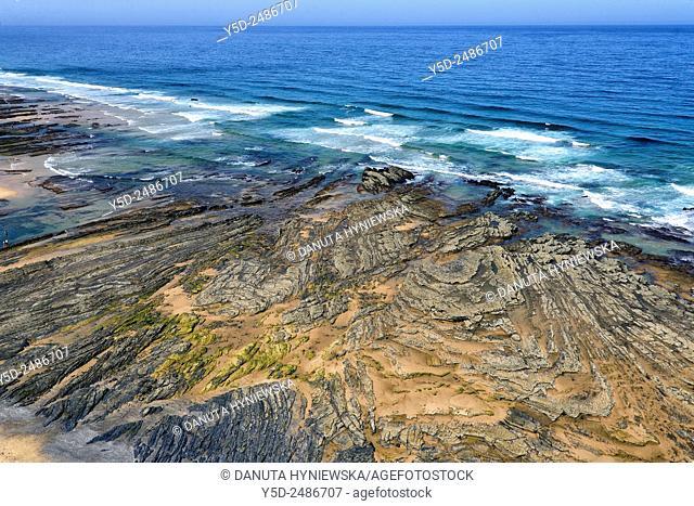 Europe, Portugal, Algarve, Faro district, Aljezur, Costa Vicentina, Monte Clérigo beach, Praia do Monte Clérigo, looking carefully you can notice a tiny point...
