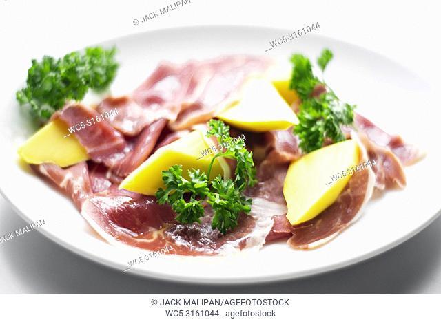 jamon serrano parma prosciutto style smoked ham with mango fruit starter tapas
