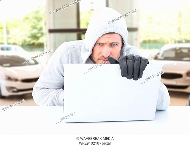 Criminal car fraud man with laptop in front of cars shop