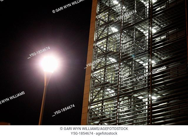office block at night in the eur district of rome italy