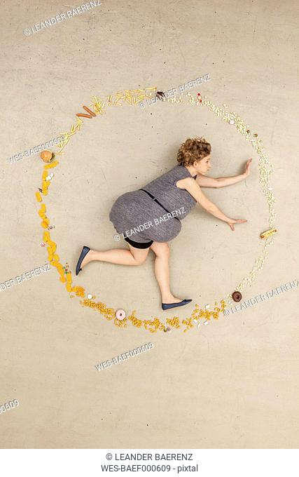 Germany, Berlin, Woman surrounded with food