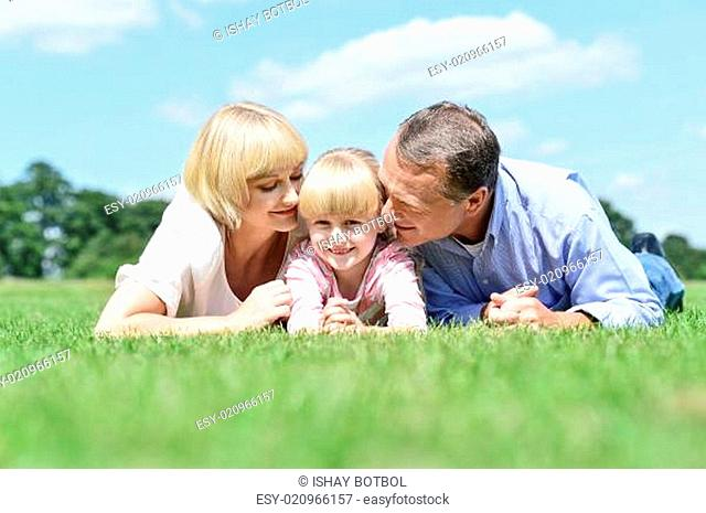 Parents kissing their sweet angel