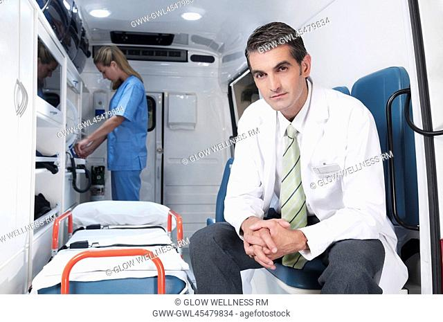 Doctor with a female nurse in an ambulance